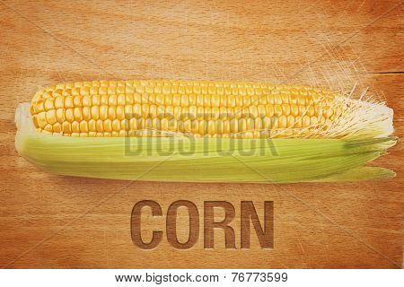 Corn Maize Cob On Wooden Background