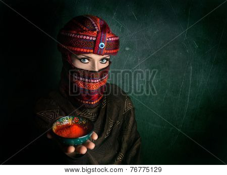 Woman In Turban With Red Chili