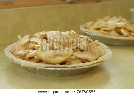 Apple pies being made by hand