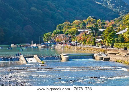 Boat on the Katsura River  in Arashiyama, Kyoto, Japan. Katsura River area features some of the oldest shrines in Kyoto and Japan.