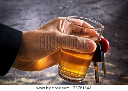 Man Behind Car Key And Glass