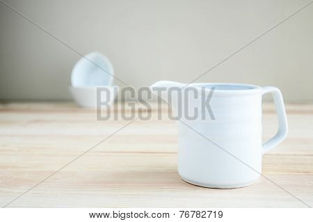 Square White Cup Over Wooden Table