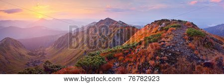 Morning landscape at dawn. Mountain panorama with the warm light of the rising sun. Carpathians, Ukraine, Europe