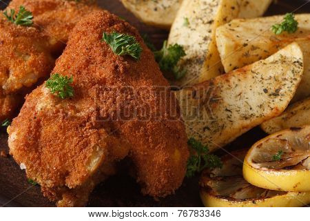Chicken Wings Dipped In Batter Macro With Potatoes And Lemon