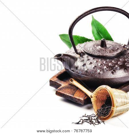 Closeup Of Asian Teapot And Dried Tea