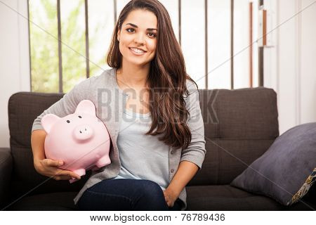 Happy Girl With A Piggy Bank