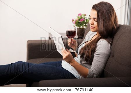 Drinking Wine And Using A Tablet
