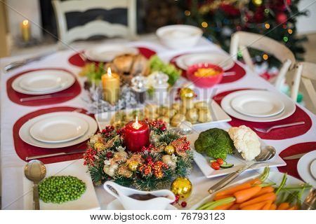 Table set for christmas dinner at home in the living room