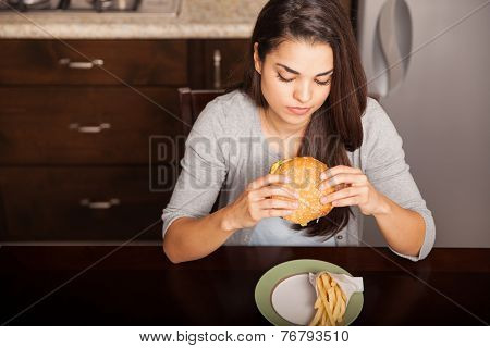 Eating A Burger And Fries