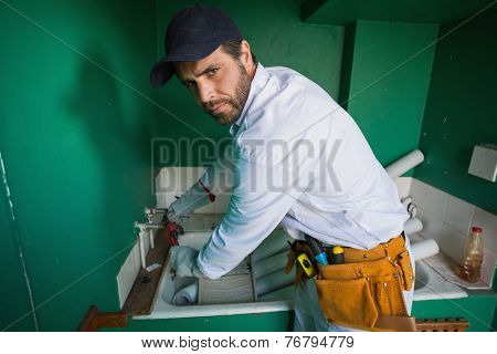 Construction worker frowning at camera in a new house