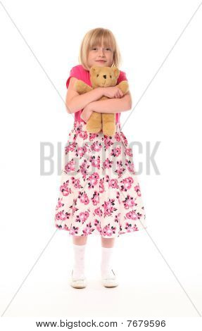 Young Little Girl Cuddling Teddy Bear