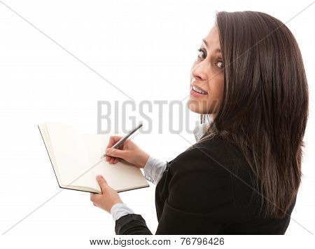 Businesswoman writing in personal organizer