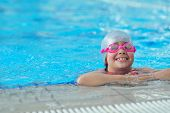 foto of swimming  - group of happy kids children at swimming pool class learning to swim - JPG