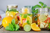 stock photo of mint-green  - Mug delicious refreshing drink of mix fruits with mint on wooden infused water - JPG