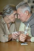 pic of influenza  - Elderly caucasian couple ill with influenza at home - JPG
