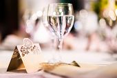 stock photo of wedding table decor  - Wedding table. Close-up of wine glass and name card ** Note: Visible grain at 100%, best at smaller sizes - JPG