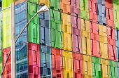stock photo of oblong  - Building facade reflected on colored windows of Montreal Convention center
