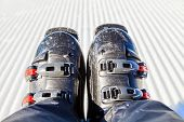 stock photo of ski boots  - Closeup photo of ski boots on snowy background - JPG