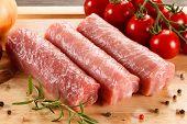 pic of pork chop  - Raw pork chops on cutting board and vegetables - JPG