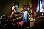 stock photo of letters to santa claus  - Santa Claus portrait at home reading children - JPG
