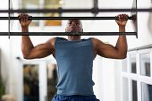 picture of pull up  - strong african man doing pull - JPG