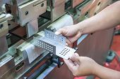 image of manufacturing  - Worker at manufacture workshop operating cidan folding machine - JPG