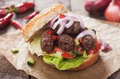 picture of burger  - Turkish kebab grilled meat in burger bun with onion and salad - JPG