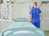 image of icu  - Doctor prepare place in an advanced modern intensive care unit  - JPG