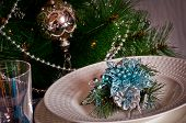 stock photo of christmas dinner  - table set for christmas dinner with decoration blue and silver with Christmas tree and set the mood for Christmas  - JPG