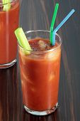 stock photo of bloody mary  - Bloody Mary cocktail on a veneered counter top.