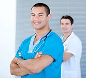 image of male nurses  - Handsome male doctor looking at the camera in the hospital - JPG