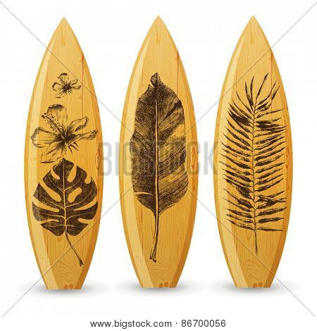 3 wooden surfboards with hand drawn tropical leaves