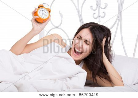 Tired Young Woman Holding Alarm Clock Isolated