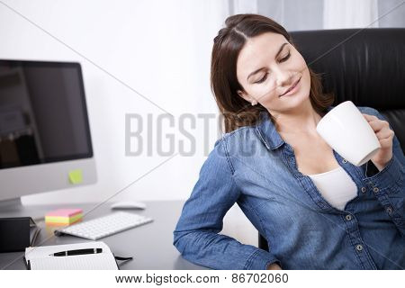 Regretful Businesswoman Eyeing Her Empty Mug