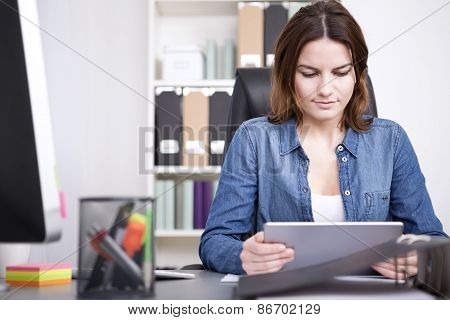 Businesswoman Reading Information On Her Tablet