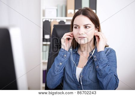 Businesswoman Listening To A Dictation