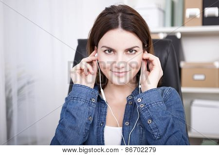 Woman Sitting Listening To Music Or A Recording