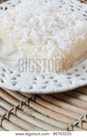 Sweet Couscous Pudding With Coconut On White Vintage Plate On Wooden Table