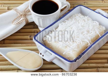 Sweet Couscous (tapioca) Pudding (cuscuz Doce) With Coconut, Cup Of Coffee And Condensed Milk On Bam