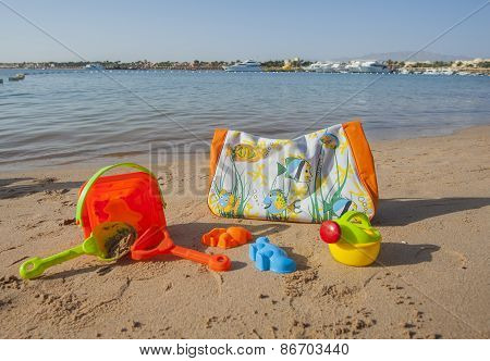 Beach Bag And Toys On The Beach