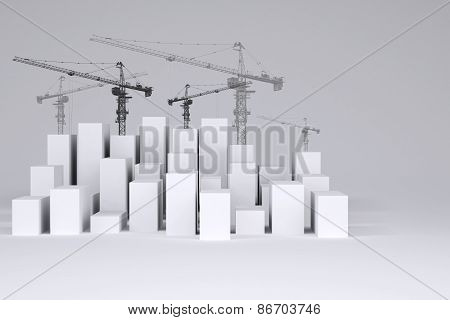 White cubes with wire-frame tower cranes on gray background