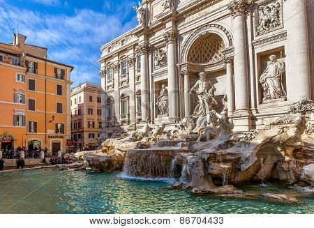 ROME, ITALY - JANUARY 15, 2013: Fontana di Trevi - largest Baroque fountain in Rome and one of most famous in the world, designed by architect Nicola Salvi. It is 26.3 meters high, 9.15 meters wide.