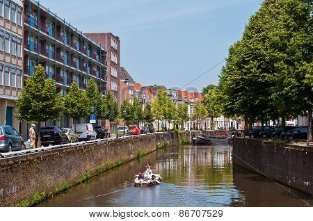 Canals and traditional Dutch architecture houses in historical town Den Bosch