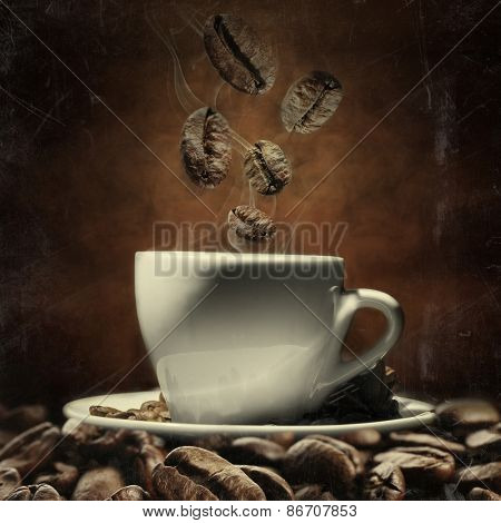 Cup of coffee with beans on dark background