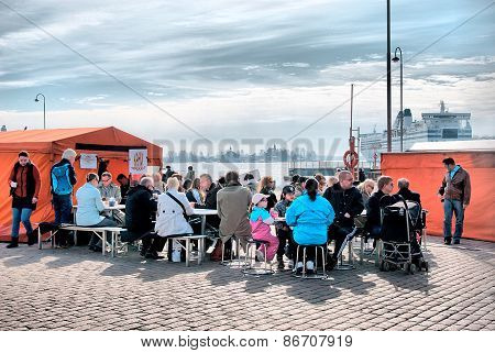Helsinki. Finland. People on the Market Square
