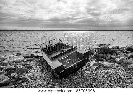 Old Fishing Motor Boat On Lake Coast
