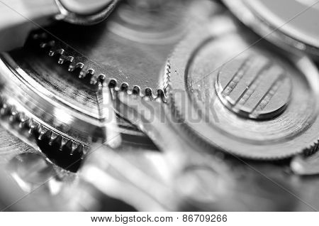 Background With Metal Cogwheels A Clockwork. Macro