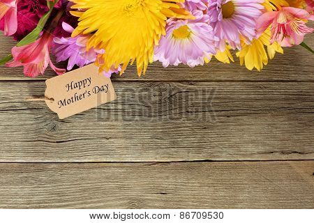 Mothers Day tag with flower border on wood