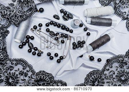 Handicrafts background. Thread, pins, thimbles.