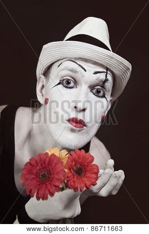 Mime In White Hat With Bouquet Of Red Gerberas